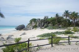 Empty beach area and temple on top of a hill at Tulum Ruins.jpg