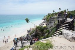People wading in the waters off of the Tulum Ruins beach.jpg