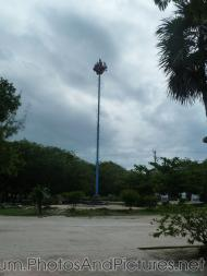 Several performers on top of a tall pole at shopping center of Tulum Ruins.jpg