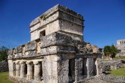 Standing tulum Mayan Ruin with carvings.jpg