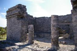 Tulum Mayan Ruin with two pillars and building.jpg