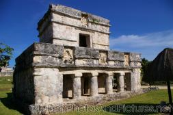 Tulum ruins two story temple with four pillars on one side.jpg