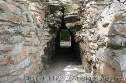Tunnel through wall at Tulum Ruins.jpg