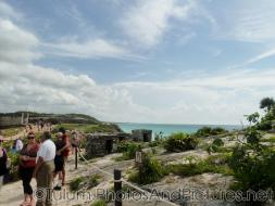 View of the ocean from a walking path at Tulum Ruins.jpg