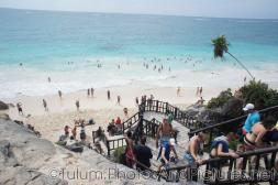 Wooden stairway to busy beach at Tulum Ruins.jpg
