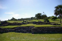 Workers work to restore and maintain the Tulum Mayan Ruins.jpg