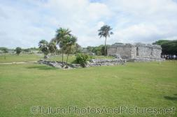 Building with walls still standing and another with only foundation remaining at Tulum Ruins.jpg