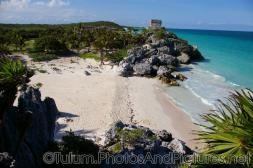 Deserted white sand beach at the Tulum Mayan Ruins site.jpg